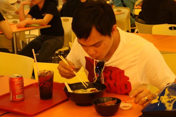 enjoying his noodle soup :)