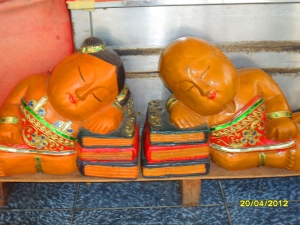 sleeping Buddhist kids display captures my attention